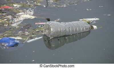Plastic water bottle. - A discarded plastic water bottle...