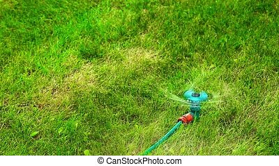 Plastic water sprayer in motion on a hot summer day HD 1920x1080