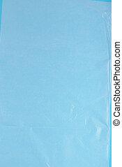 Plastic wrap on blue background