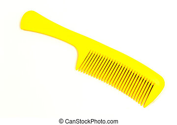 Plastic yellow comb isolated on white