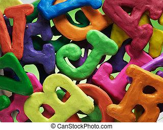 plasticine alphabet letters vibrant background