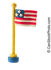Plasticine American flag on a flagpole on a white background