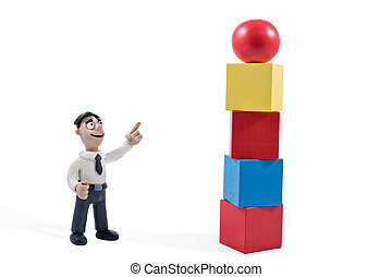 Plasticine businessman points to the tower