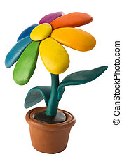 Plasticine colorful flower with leaves in brown pot