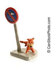 plasticine handmade dog, pee on signal pole isolated over...