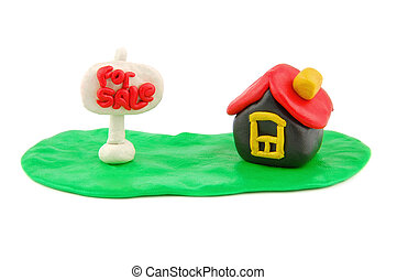 Plasticine house and For Sale real estate sign