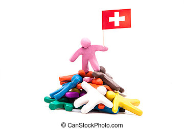 Plasticine man with the Swiss flag
