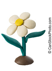 Plasticine white flower with leaves growing on the ground
