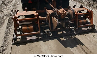 Plate compactor mounted on truck. - Plate compactor is...