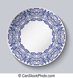 Plate decorated with blue floral patterns in the style of the national porcelain painting with empty space in the center isolated on gray background.