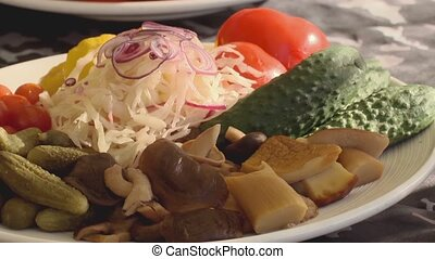 Plate fool of tomato, cucumbers, mushrooms, bow and cabbage....