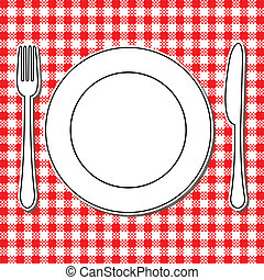 Plate, fork and knife on tablecloth