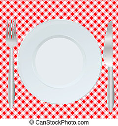 Plate, fork and spoon on red square tablecloth