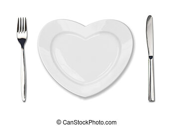 plate in shape of heart, table knife and fork isolated on white