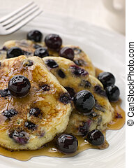 Plate Of Blueberry Pancakes With Maple Syrup