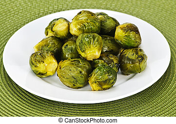 Plate of brussels sprouts - Plate of roasted green brussels...