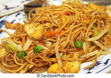 Plate of Chicken Chow Mein. A Chinese food dish of fried...