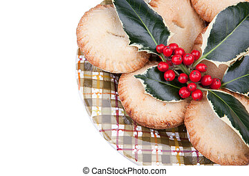 Plate of christmas mince pies with holly