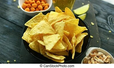 Plate of corn chips with nuts - From above shot of composed...