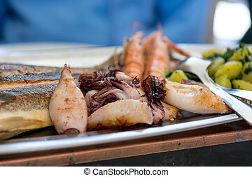 Plate of delicious grilled sea food.