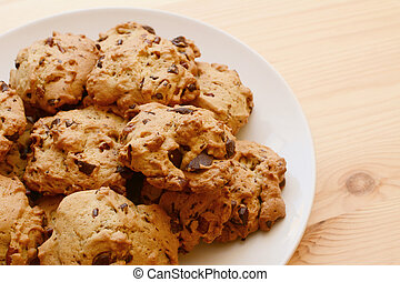 Plate of delicious pecan and chocolate chip cookies