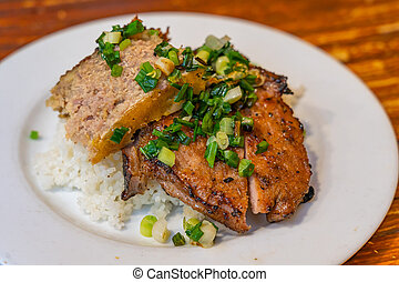 Plate of delicious Vietnam flavored grilled pork chop white rice