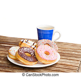 plate of donuts and blue coffee mug