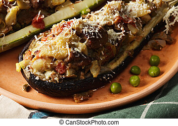 Plate of eggplant and zucchini boats closeup