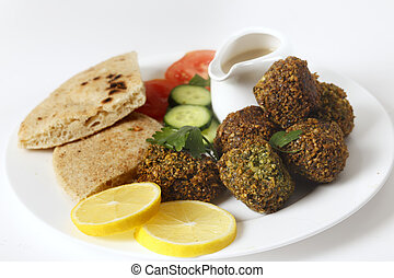 Plate of falafel with breat and salad