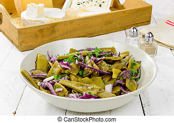 plate of fresh green beans and red onions