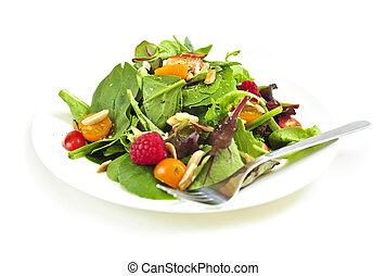 Plate of green salad on white background