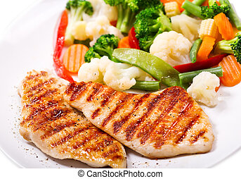 plate of grilled chicken with vegetables