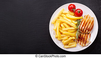 plate of grilled pork chop with french fries