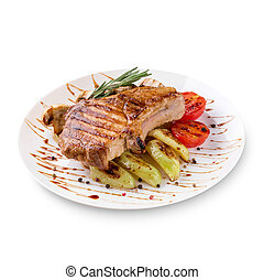 Plate of grilled steak meat with vegetables on white background