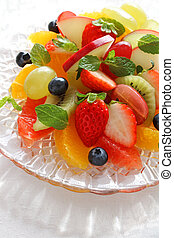Plate of healthy fresh fruit salad