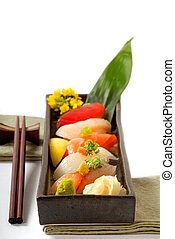 Plate of Japanese sushi with chop sticks - Fresh Japanese...