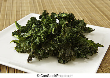 Plate of Kale Chips - Plate of roasted kale chips on a ...