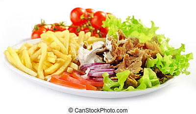 Plate of kebab and vegetables