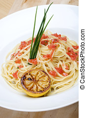 Plate of linguine topped with diced tomatos - Beautiful...