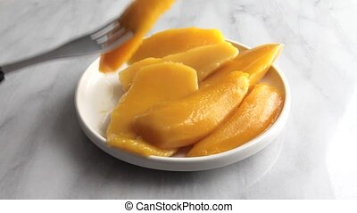 Plate of mango slices being eaten - Video of a full plate of...
