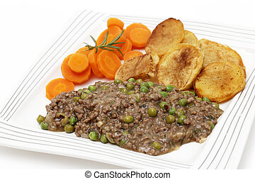 Plate of mince and peas with carrots and potato - Minced...