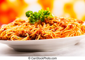plate of of spaghetti bolognese with parsley