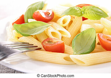 plate of pasta with tomato and basil