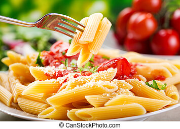 penne pasta - plate of penne pasta with tomato sauce