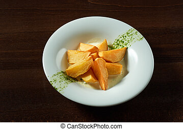 Plate of roasted potatoe at the restaurant
