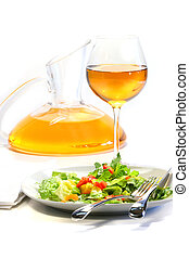 Plate of salad and wine glass