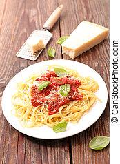 plate of spaghetti, tomato sauce, parmesan and basil