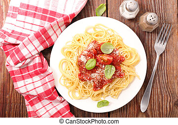plate of spaghetti with tomato sauce, parmesan and basil