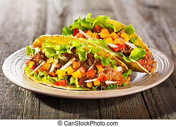 plate of taco on wooden table