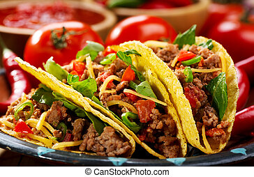 plate of tacos on wooden table